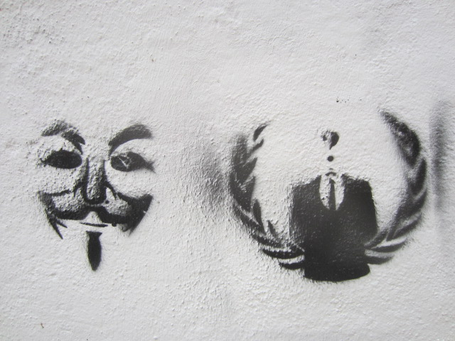 "The two symbols of ""Anonymous"" - Guy Fawkes and the headless man, stenciled onto the wall of an ancient palace"